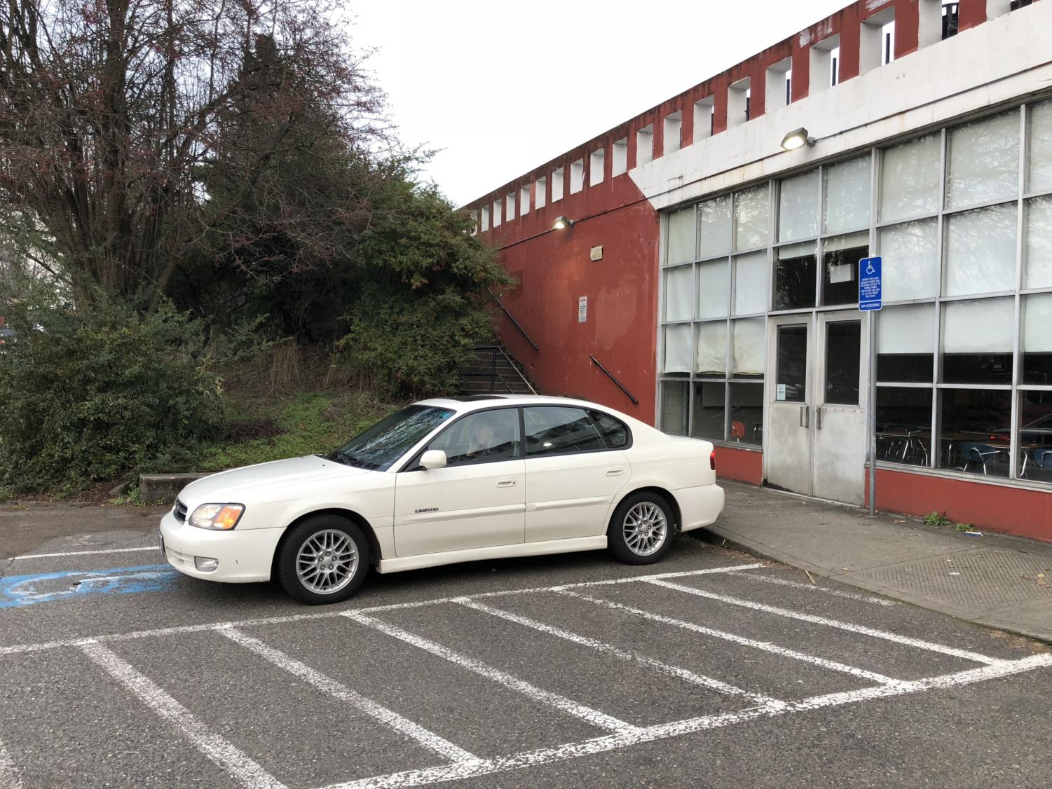 A car without a permit sits parked in a handicap spot outside of the cafeteria. According to PPS district policy, all handicap spots on campus are designated for staff with handicap passes and visitors, not students with a disability.