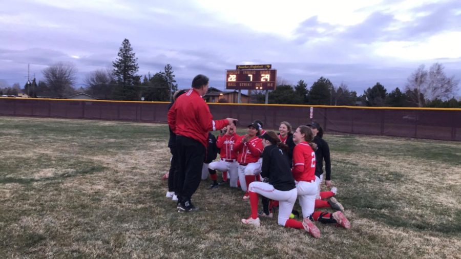 The+softball+team+celebrates+after+a+29-28+comeback+win+over+Summit+High+School+during+a%0Atournament+in+Bend.+The+team+is+ranked+29th+in+the+state.