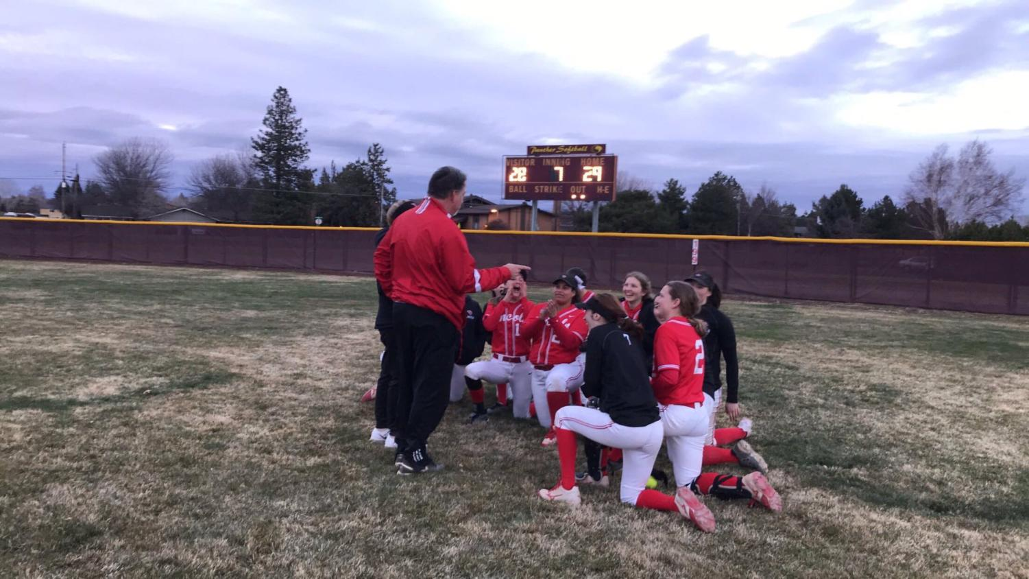 The softball team celebrates after a 29-28 comeback win over Summit High School during a tournament in Bend. The team is ranked 29th in the state.