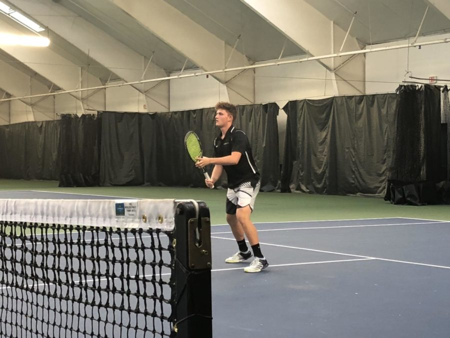 Junior Avi Shugar prepares to play a shot during a match against Oregon Episcopal School on April 16. Shugar, who transferred to Lincoln this year, hopes to lead the team to a state championship.