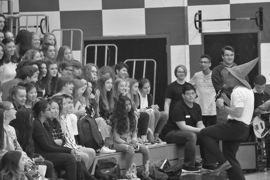 """Bailey leads his final cheer wearing his classic hat for the freshman class during the 2018 May Fete assembly on May 11, cheering, """"Hey Lincoln, how you feel?"""" Students respond, """"we feel good, oh we feel so good!"""""""