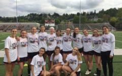 Girls lacrosse focusing on teamwork