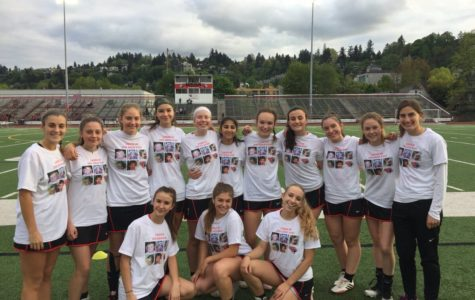 Girls lacrosse focusing on teamwork