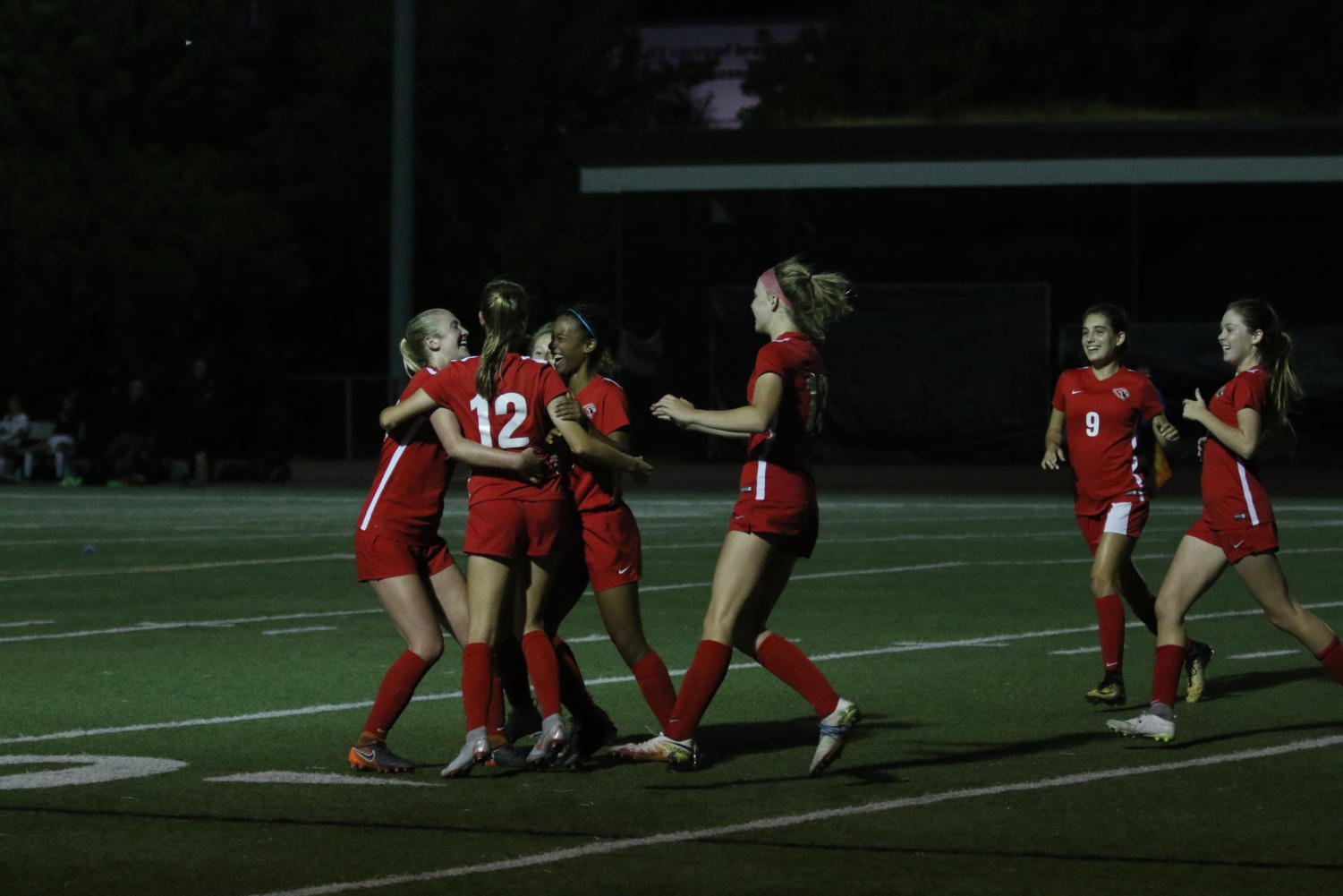 Girls varsity soccer team celebrates sophomore Jolie Maycumber's (number 12) game winning goal against South Eugene on Aug. 30 2018.