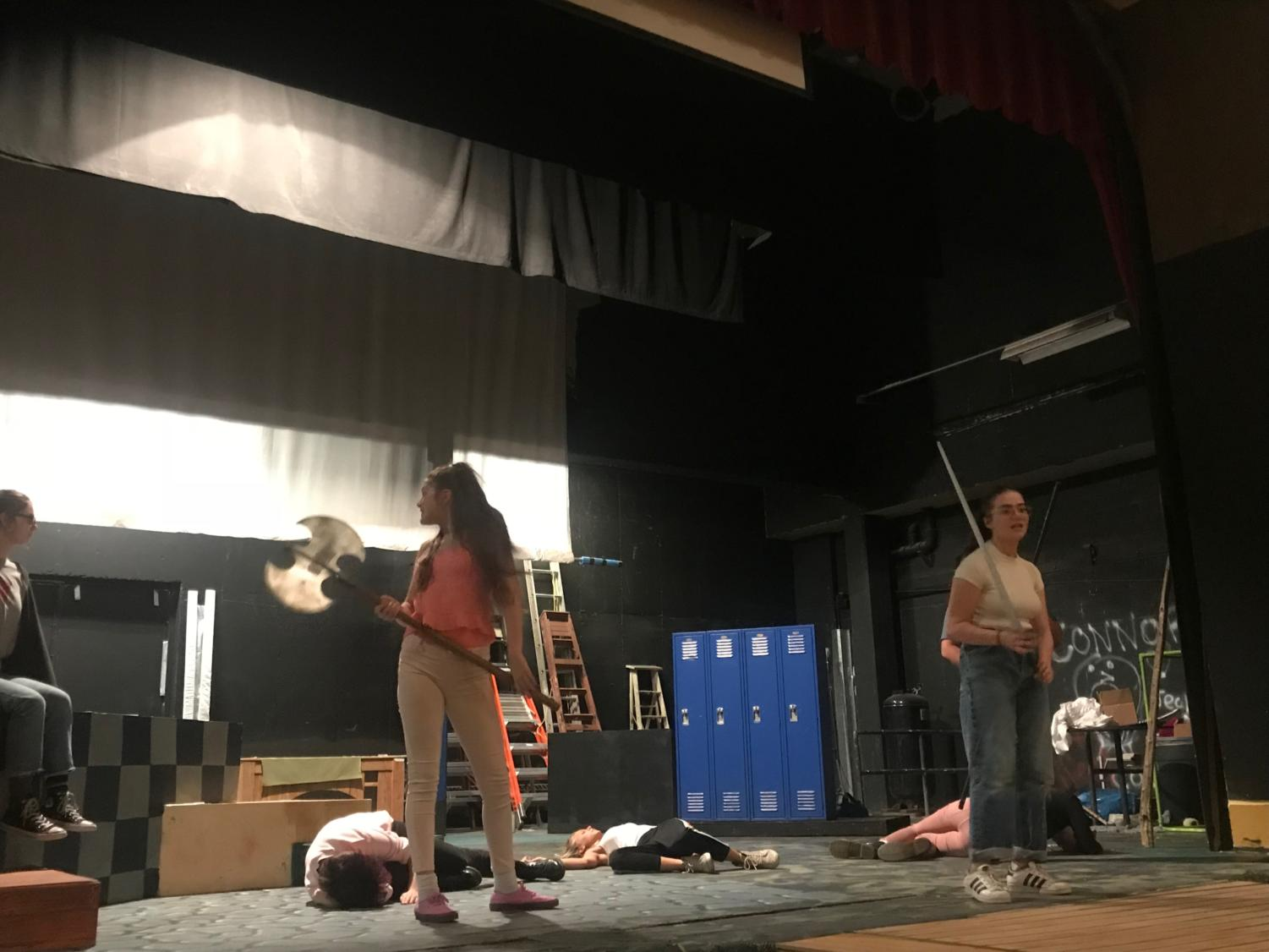 "Students rehearse for ""She Kills Monsters,"" a science fiction story about how a young girl attempts to reconnect with her sister through the game Dungeons and Dragons."