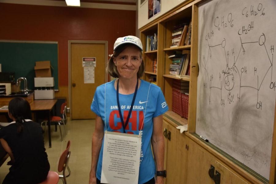 Maureen Kenny poses in her Halloween costume as Joan Benoit Samuelson, the first ever women's Oylmpic games marathon champion