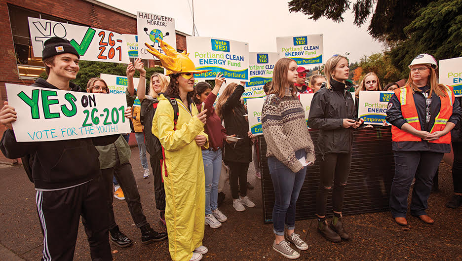 From left to right: Senior Wyatt Jenkerson, senior Carmen Vintro, senior Hailey Fisher, and senior Bella Klosterman at the Environmental Justice Club Oct. 31 rally in support of the Portland Clean Energy Initiative. Klosterman and Vintro started the club this year and have taken leadership positions.
