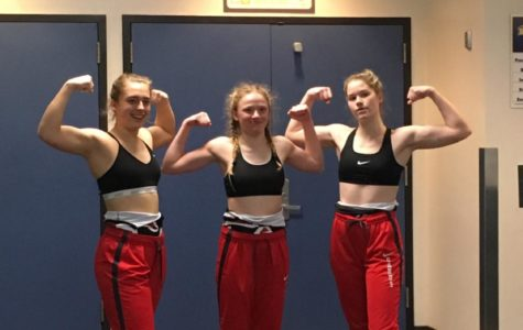 On the centennial celebration of Oregon high school sports, the OSAA recognized girls' wrestling as a sport for the first year. From left to right: Senior Natalie Brauser, sophomore Sophie Keefer, and senior Isabel Slevin at the Hood River Valley Tournament. They have led Lincoln's first official girls' wrestling team to a successful inaugural season, sending two wrestlers to the state meet.