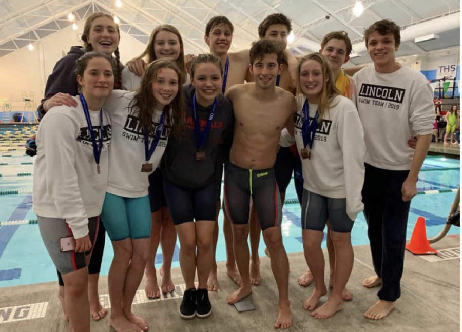 Lincoln%E2%80%99s+swim+team+pose+for+a+photo+at+the+state+swim+meet.+The+team%0Awon+the+PIL+championships+in+February+and+sent+several+athletes+to+the+state+meet.
