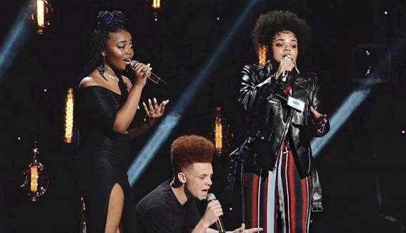Charlotte Odusanya, with two other American Idol participants, perform in front of the judges in Hollywood.