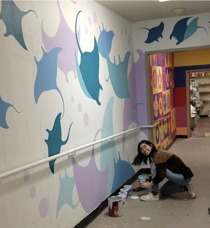 Senior+Selena+Yao+paints+a+mural%2C+in+collaboration+with+Anna+Tillier%2C+in+a+Lincoln+hallway.