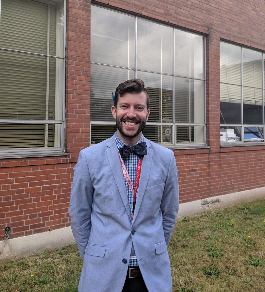 Chris Brida poses in the Lincoln courtyard. Brida is one of Lincoln's newest administators.