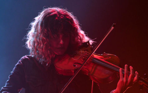 Violinist, Lisa Molinaro, plays onstage for the band Modest Mouse.