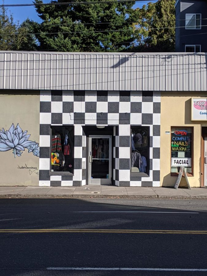 Hawthorne%E2%80%99s+Focus+Group+Shop+has+a+bright+checkerboard+pattern+that+makes+it+quickly+recognizable+to+passing+pedestrians.