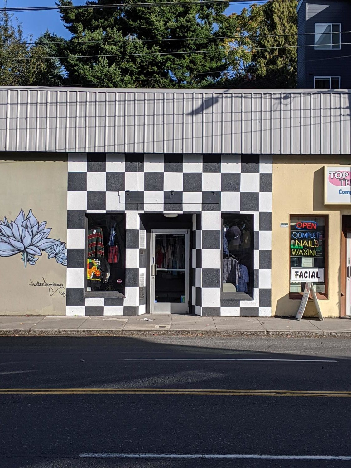 Hawthorne's Focus Group Shop has a bright checkerboard pattern that makes it quickly recognizable to passing pedestrians.