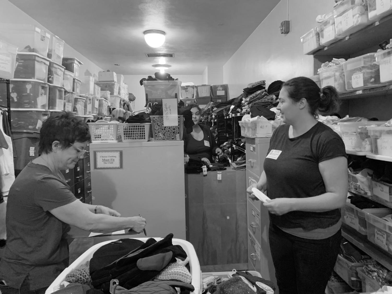 Supervisor Susan Samojlovski and parent volunteer Vanessa Kinyon  working hard at the clothing closet.