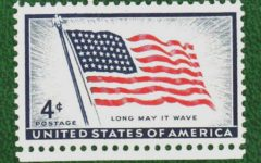 A US Postal stamp featuring the American Flag, courtesy of Wikimedia Commons.