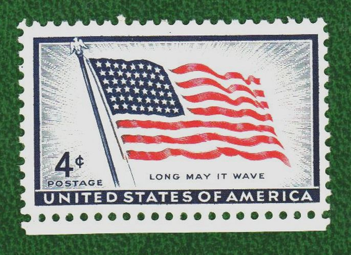 A+US+Postal+stamp+featuring+the+American+Flag%2C+courtesy+of+Wikimedia+Commons.