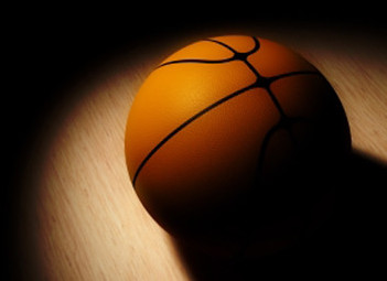 A basketball sits on the court. Photo by Ticket Club is licensed under CC BY-SA 2.0