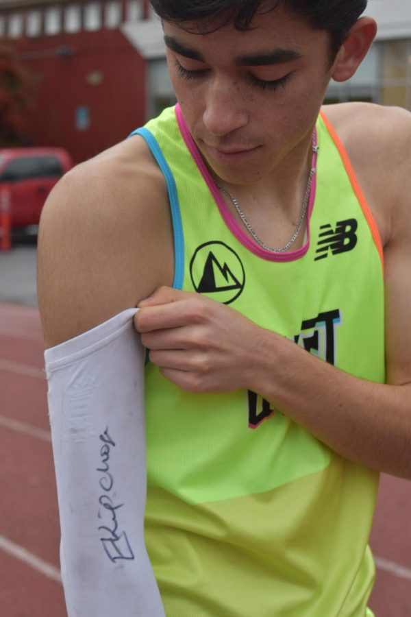 Mateo Althouse suits up the the Mike Walsh field, wearing his signature arm sleeve signed by the marathon world record holder Eluid Kipchoge.