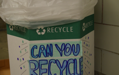 A decorated recycling bin is located inside senior hall. Many of these bins are spread out across the school to promote sustainability.