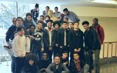 Lincoln Vice Principal James McGee (middle, bottom row) poses with members of Brothers of Color at the end of freshman hall. McGee has accepted a job as the principal of Grant High School.