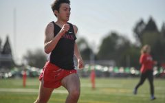 Senior Ethan Harper runs a 400 meter dash at Wilson during his junior year.