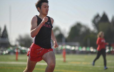 Senior Ethan Harper runs a 400 meter dash at Wilson during his junior year.