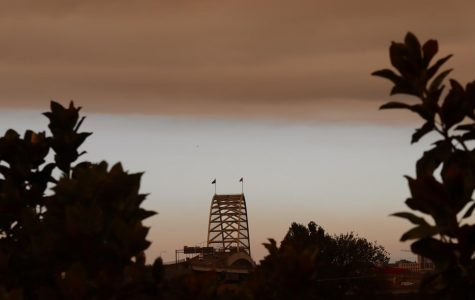 The Fremont Bridge appears shadowy in the distance under layers of smoke.