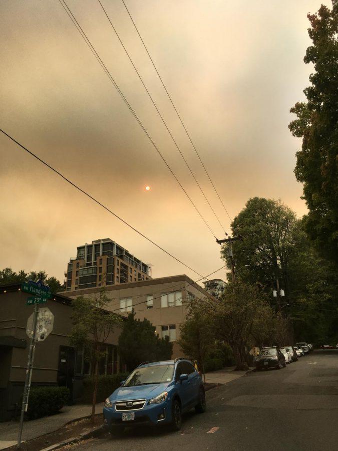 The sun glows red behind smoke near 23rd Avenue in NW Portland.