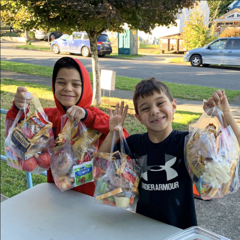 These two students among others received their lunch pack for the week. From 3 to 5 p.m. on Mondays, Wednesdays and Fridays, families can pick up meals.