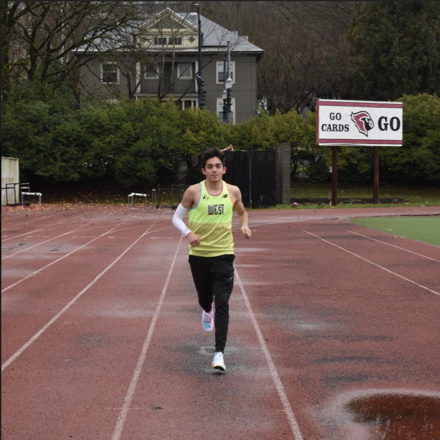 Mateo Althouse jogs around Mike Walsh Field last winter, before construction started. Althouse has been keeping busy recently by running time trials by himself, running 8:36 for 3 kilometers last Saturday.