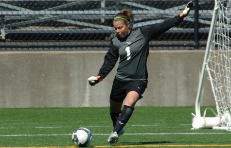Lainey Hulsizer kicks a ball during a soccer game for the Portland State Vikings. Hulsizer is the Lincoln girls
