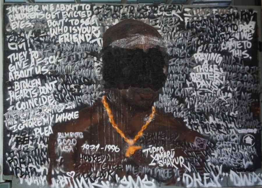 A black lives matter mural that has statements written across it of protest speech.