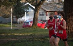Junior Charlie Townes, left, and sophomore Trevor Dix, right, race in masks.