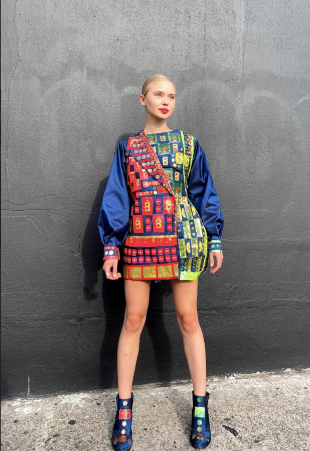 Hudson wears her Russian Candy Wrapper Dress, which she was inspired to create after seeing the intricate patterns in a Russian candy store.