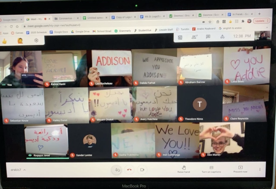 The Arabic 7-8 class holds up signs of appreciation for the teacher.