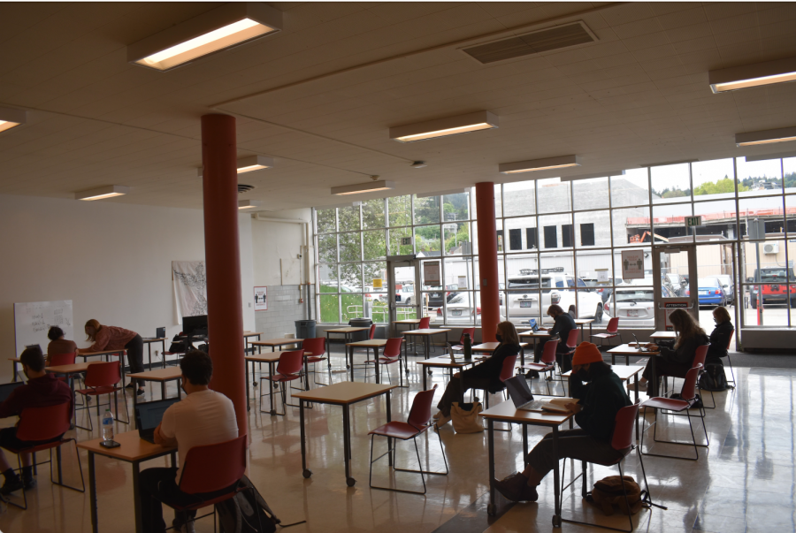Students sit in the Lincoln High School Cafeteria during a period of hybrid learning. April 19 marked the first day of in-person learning since March 13, 2020, ending over a year of distance learning.