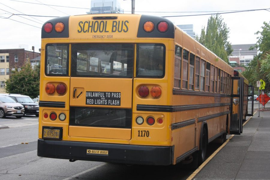A bus waiting for students outside of Lincoln. District wide bus route cancellations have created challenges for Lincoln students struggling to get to school.
